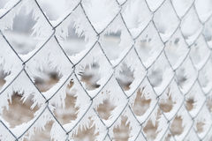 Frozen fence wires closeup in winter background Stock Photo