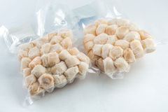 Frozen fillet scallop shells. Packaged for sale in the store Royalty Free Stock Photography