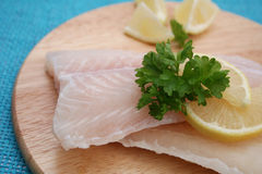 Frozen fish. Some frozen fish on a wooden plate Royalty Free Stock Photos