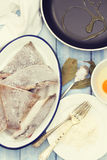 Frozen fish with egg Stock Photos