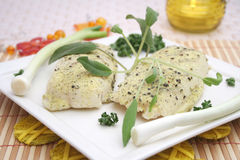 Frozen fish. Some frozen fish with pepper seeds Stock Image