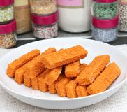 Frozen fish. Some frozen fish sticks on a plate Royalty Free Stock Photo