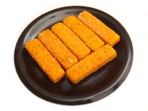 Frozen fish. Some frozen fish sticks on a plate Stock Images