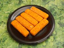 Frozen fish. Some frozen fish sticks on a plate Stock Photography