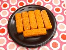 Frozen Fishsticks. Some frozen fishsticks on a plate Stock Photos
