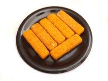 Frozen Fishsticks. Some frozen fishsticks on a plate Stock Photo