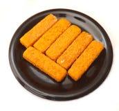 Frozen Fishsticks. Some frozen fishsticks on a plate Royalty Free Stock Photo