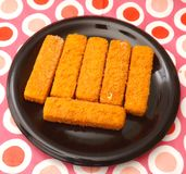 Frozen Fishsticks. Some frozen fishsticks on a plate Royalty Free Stock Images