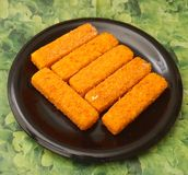 Frozen Fishsticks. Some frozen fishsticks on a plate Royalty Free Stock Photography