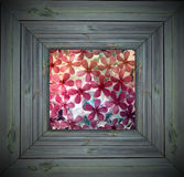 Frozen Flowers in Wooden Frame. Beautifl tiny pink flowers in a retro wood frame Royalty Free Stock Images