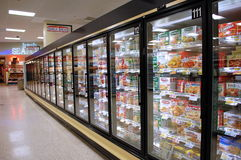 Frozen Food Aisle. Frozen food cases in a supermarket aisle stock images