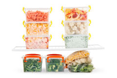 Frozen food in the refrigerator. Vegetables on the freezer shelves. Stock Photography