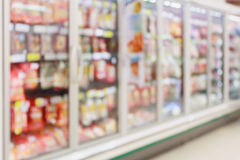 Frozen food section in supermarket blur. Red background Stock Image