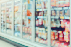 Frozen food section in supermarket blurred background Stock Images