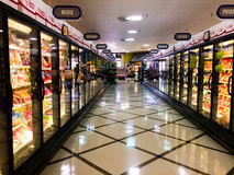 Frozen foods aisle of grocery store. royalty free stock image