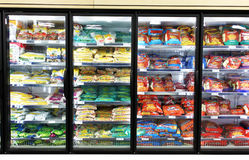 Frozen foods shelves. Frozen foods on shelves in a supermarket in Toronto, Canada Royalty Free Stock Photo