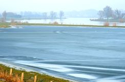 Frozen fore-lands in Holland. After long raining the water level of the river IJssel in the Netherlands is very high resulting in flooded fore-lands which have Royalty Free Stock Photos