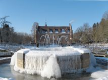 Frozen fountain at castle. A frozen fountain in the gardens of castle Terworm in the Netherlands royalty free stock photo