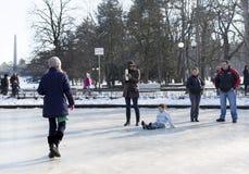 Frozen fountain family play Royalty Free Stock Image