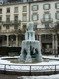 Frozen fountain in Zurich. lamppost. stock image