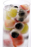 Frozen Fruit Cocktail. Exotic cocktail with frozen fruit as closeup in a glass on white background Royalty Free Stock Images