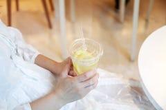 Frozen fruit drink. Frozen lemon fruit drink in a woman hand Stock Photo