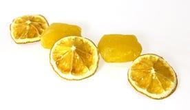 Frozen fruit,  lemon juice frozen ice cubes isolated on white ba. Ckground. Feminine, beauty and cosmetics concept Royalty Free Stock Images