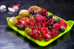 Frozen fruit. On a wooden surface Royalty Free Stock Photography