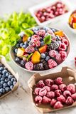 Frozen fruits blueberries blackberry raspberry red currant peach and herbs melissa.  stock photo