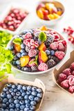 Frozen fruits blueberries blackberry raspberry red currant peach and herbs melissa.  royalty free stock photo