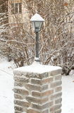 Frozen Garden Lamp. Outdoor garden lamp covered by snow in winter time Royalty Free Stock Images