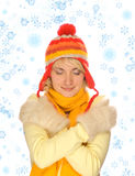Frozen girl. In colorful winter clothing and abstract snowflakes around her Stock Images