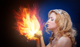 Frozen girl hold a falme in palms Royalty Free Stock Photography