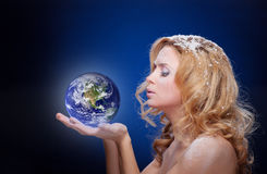 Frozen girl holding earth globe (west hemispere) Royalty Free Stock Images