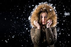 Frozen girl in snow stock photography