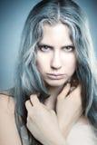 Frozen girl in the studio. Stock Images