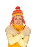 Frozen girl in winter clothing. Frozen girl in colorful winter clothing over white background Royalty Free Stock Image