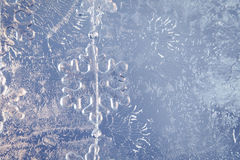 Frozen glass background. Stars chain on a frozen glass background Stock Photo