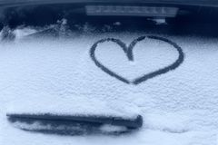 Frozen glass of a car on a winter day, drawing heart.  royalty free stock photos