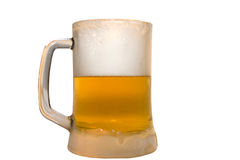 Frozen glass filled with ice cold beer Royalty Free Stock Images