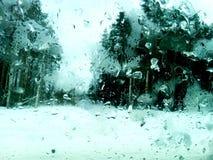 Frozen glass. View through the frozen glass Stock Photos