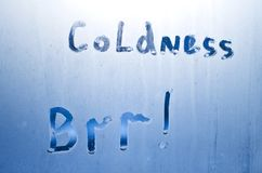 On a frozen glass it is written coldness brr. Inscription on the frozen glass royalty free stock image