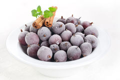 Frozen gooseberries Stock Photo