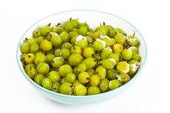 Frozen gooseberries on white Royalty Free Stock Image