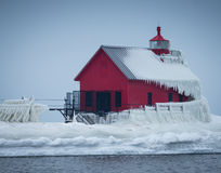 Frozen Grand Haven Lighthouse. Lake Michigan Light covered in ice Stock Photos