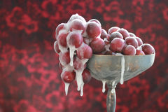 Frozen Grapes. Frozen red grapes in a tranished silver goblet Stock Images