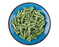 Frozen green beans in blue plate isolated on white Royalty Free Stock Photo