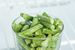 Frozen green beans in a glass in the freezer Royalty Free Stock Images