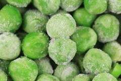 Frozen Green Peas background. Stock Photos