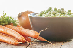 Frozen green peas with carrots Stock Photo